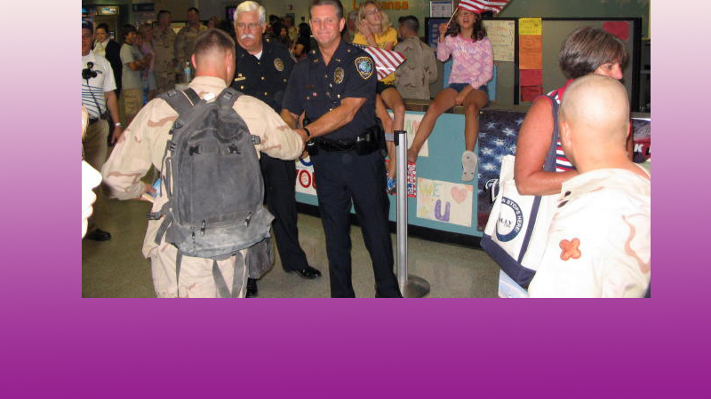Lt. Rodney Cunningham and Chief Tommy Ingram of the Colleyville PD welcome troops home at DFW. June 17, 2005