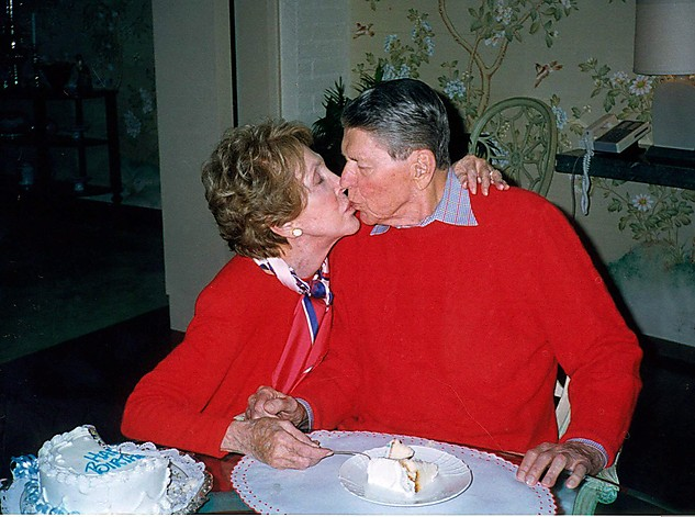 ** FILE ** Former President Ronald Reagan is kissed by his wife Nancy in this photo made inside their Bel-Air home in Los Angeles, Feb. 6, 2000, on Reagan's 89th birthday. The White House was informed that the 93-year-old former president's health has deteriorated significantly in the past several days, a person familiar with Reagan's condition said Saturday, June 5, 2004.  (AP Photo/File) ORG XMIT: NY114